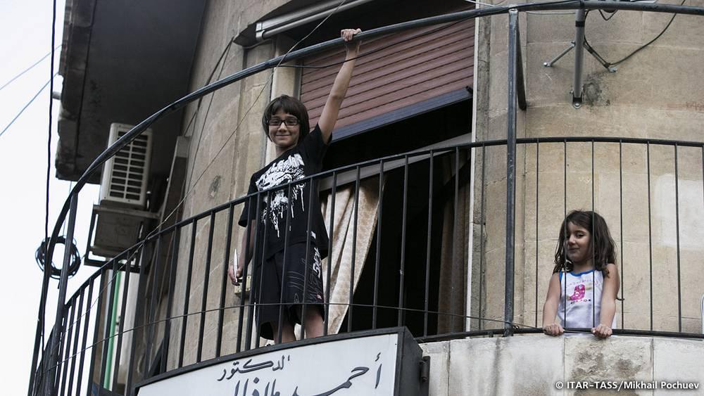 September 19. Children overlook Damascus streets.
