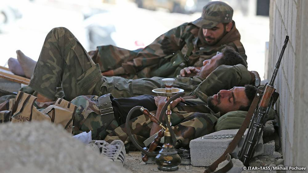 September 13. Syrian soldier rest at a security checkpoint near Maalul city.