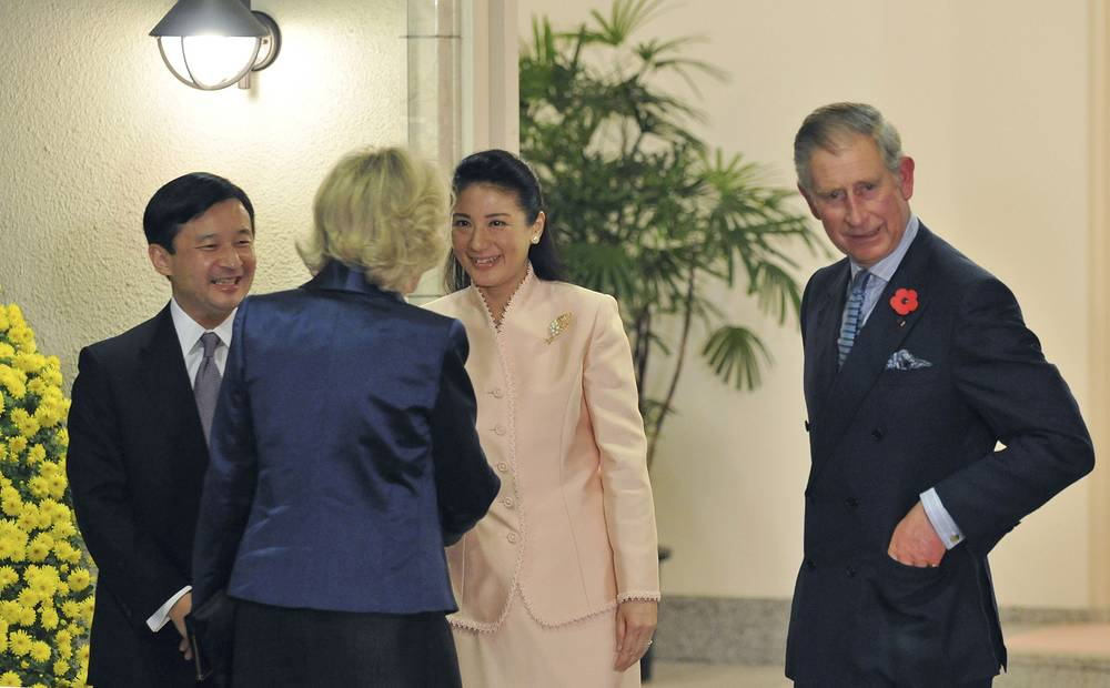 Во время встречи с британским принцем Чарльзом и его супругой. 2008 год