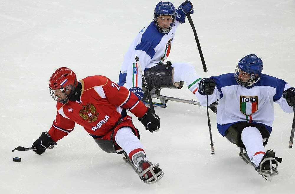 Игроки сборной России Алексей Лысов, сборной Италии Флориан Планкер и Валерио Корвино (слева направо)