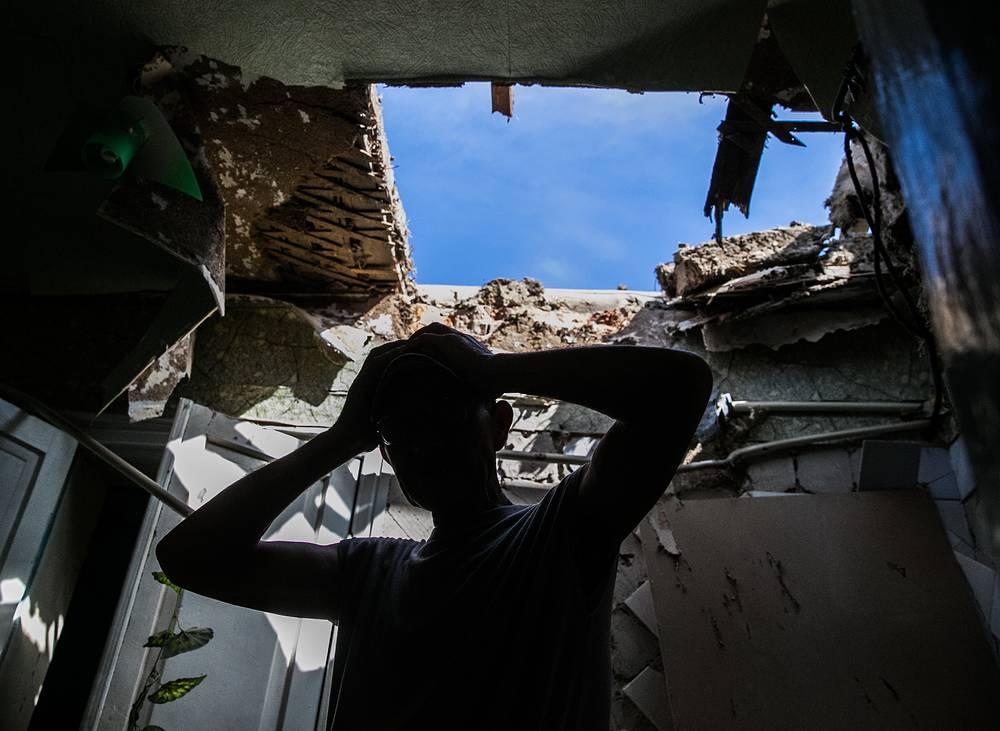 Последствия обстрела жилых домов в Славянске