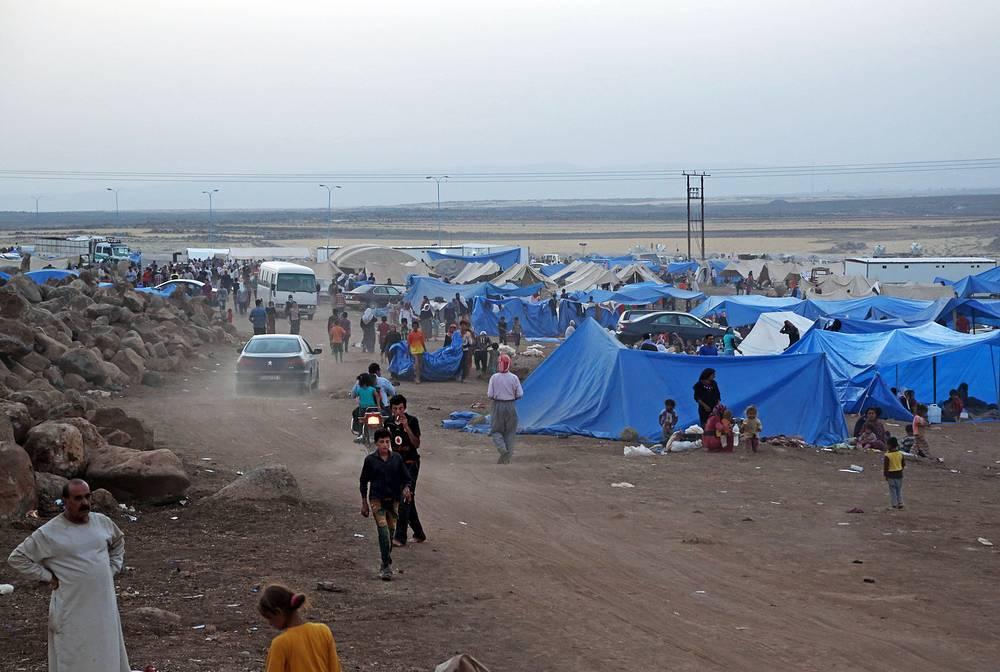 Иракские езиды в лагере беженцев возле сирийско-иракской границы