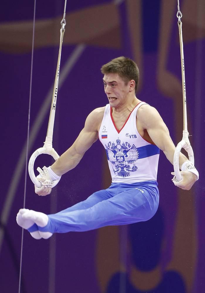 Россиянин Никита Игнатьев во время соревнований по спортивной гимнастике в дисциплине кольца