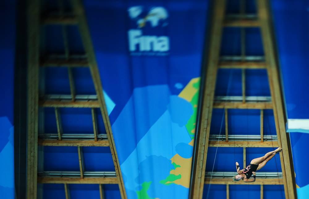 Спортсменка из Великобритании Тоня Коуч в соревнованиях по прыжкам в воду с вышки 10 м среди женщин, 30 июля