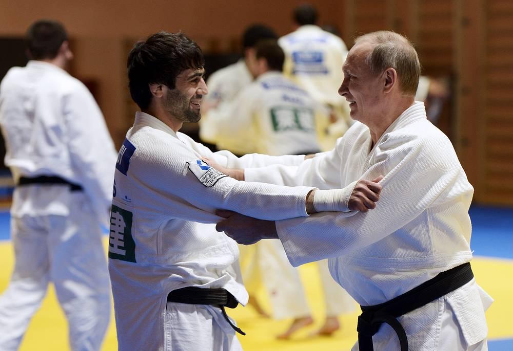 Борец Беслан Мудранов и президент России Владимир Путин