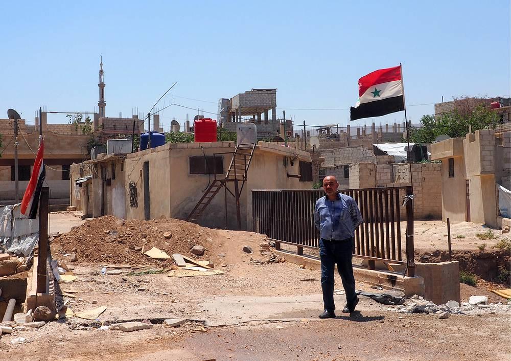 Обустройство лагеря для вынужденных переселенцев из провинции Идлиб в населенном пункте Хирджилла, Сирия
