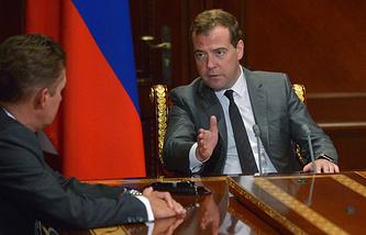 Russia's Prime Minister Dmitry Medvedev (R) and Gazprom CEO Alexei Miller (L)