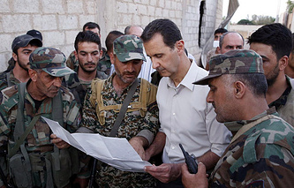 Syrian President Bashar al-Assad with Syrian soldiers