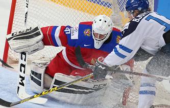 Эпизод из финального матча молодежного чемпионата мира между сборными России и Финляндии