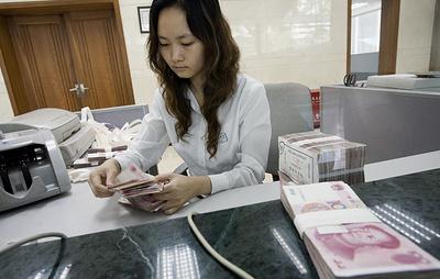 Китай понизил курс юаня к доллару до нового минимума за 11 лет