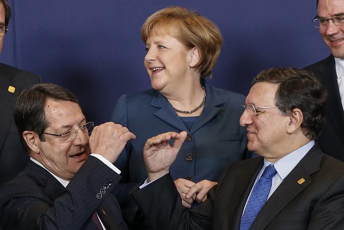 (L-R) President of the Republic of Cyprus Nikos Anastasiadis, German Chancellor Angela Merkel and President of the European Commission Jose Manuel Barroso