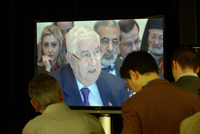 Journalists listen to the speech by Syrian Foreign Minister Walid al-Muallim at the Geneva II Peace talks at the Syria Peace Conference in Montreux