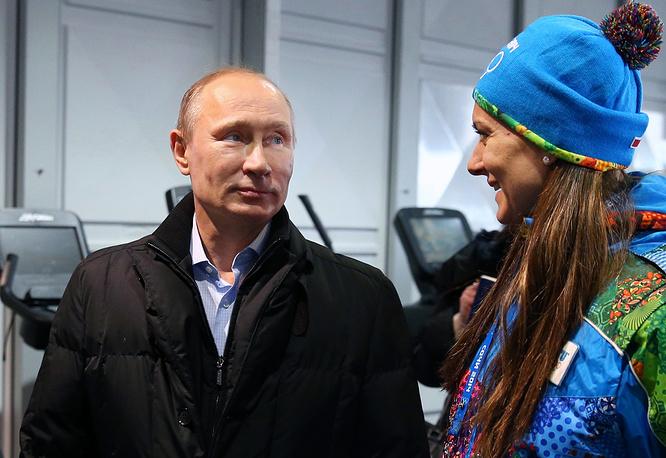 Russia's president Vladimir Putin and pole vaulter Yelena Isinbayeva