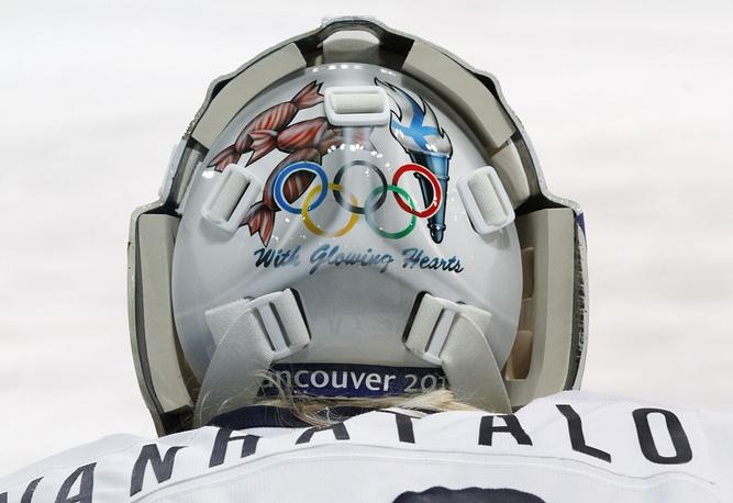 Finland's goalie Anna Vanhatalo's helmet features traditional olympic symbols