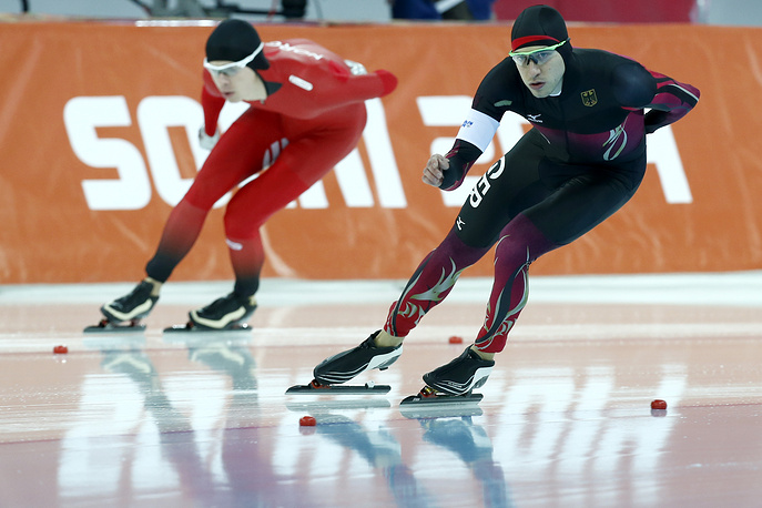 Simen Spieler Nilsen of Norway (L) and Alexej Baumgaertner of Germany in action during the Men's 5000m Speed Skating event