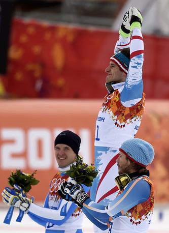 Gold medalist Matthias Mayer (C) of Austria, silver medalist Christof Innerhofer (L) of Italy, and bronze medalist Kjetil Jansrud (R) of Norway