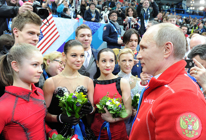 Vladimir Putin congralulates Russia Olympic figure skating team at winning gold in team competitions