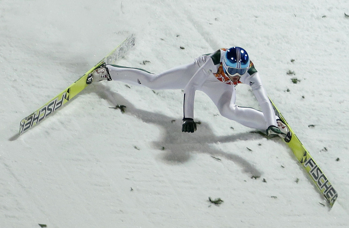lovenia's Robert Kranjec falls during the men's normal hill ski jumping qualification