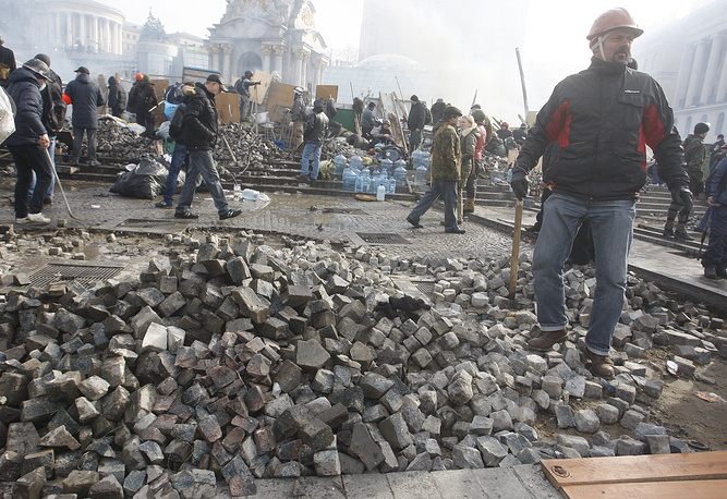 Protester must have pulled out most of the stones in Kiev's famous pavement. The cobblestones are used to throw at the riot police