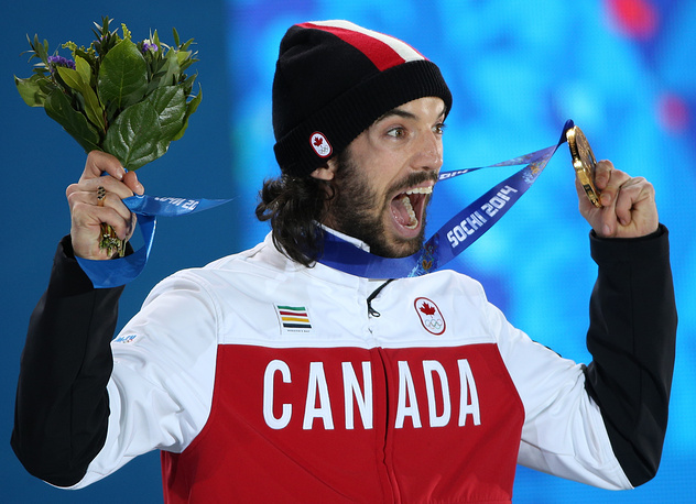 Charles Hamelin of Canada celebrates his gold in the short track men's 1500m