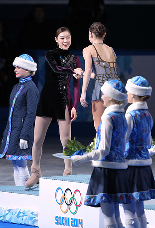 You can shake hands with your competitors. Photo: silver medalist Kim Yuna (L) of South Korea and gold medalist Adelina Sotnikova (R) of Russia