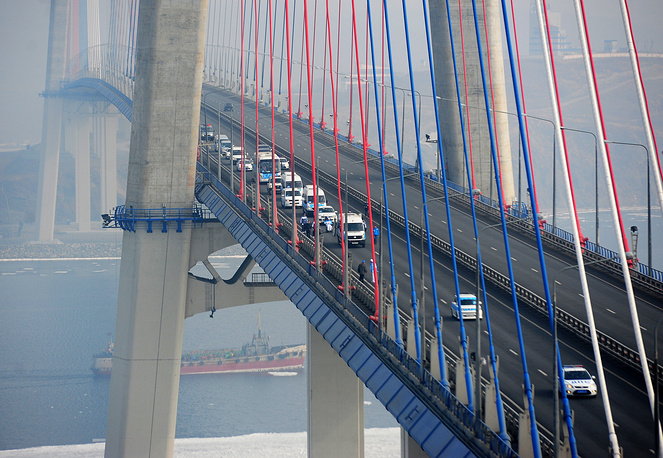 The Paralympic Flame is being carried across Russky [Russian] Bridge in Vladivostok