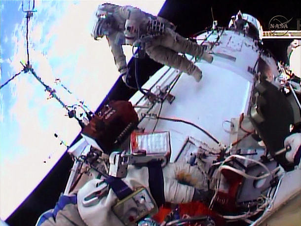Oleg Kotov and Flight Engineer Sergey Ryazanskiy during a 6-hour spacewalk to install cameras in January 2014