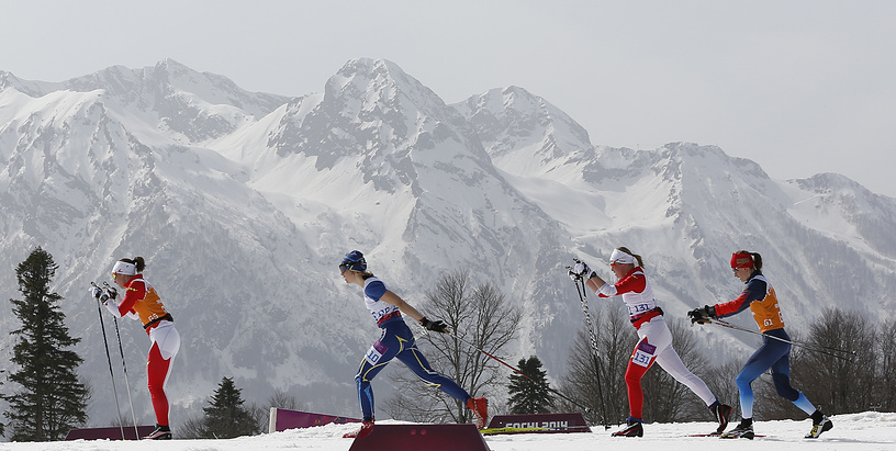 Margarita Gorbounova (2R) and Andrea Bundon (L) of Canada in action during the Cross Country Women's 15km