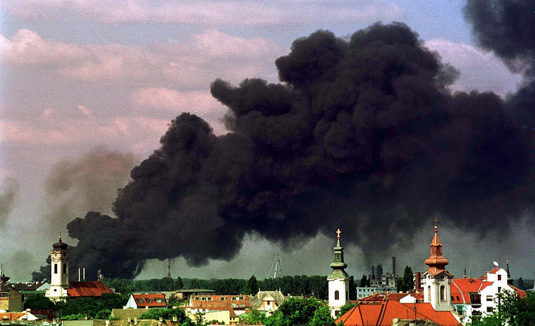 Black smoke rises from a burning oil refinery in Novi Sad