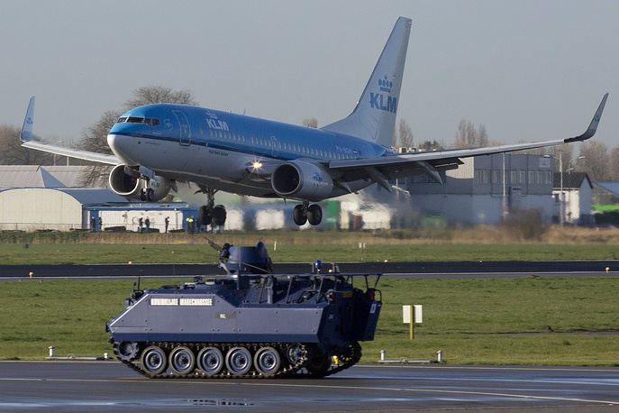 An armored vehicle secures the parameter at Schiphol airport