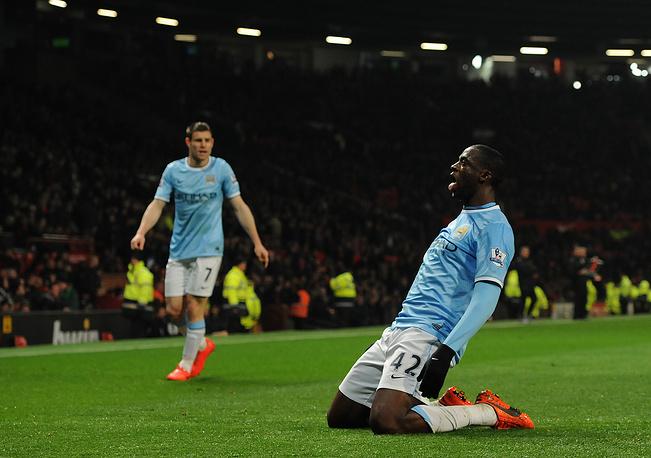 Yaya Toure celebrates scoring the third goal
