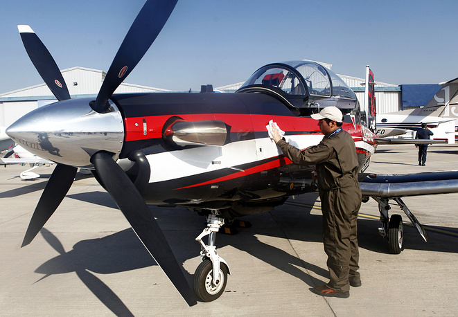 A man cleans an aircraft during the inaugural event