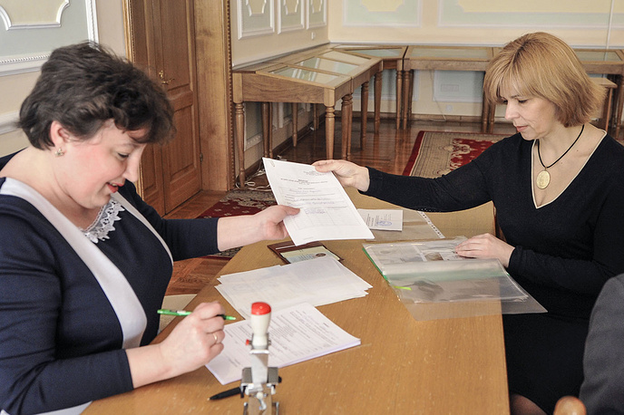 Doctor Olga Bogomolets (right) registering as a self-nominee