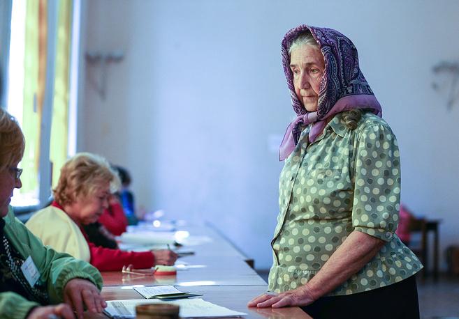A woman votes at a polling station in Sloviansk, Donetsk region