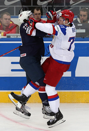 US Jake McCabe (L) and Russia's Anton Belov
