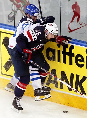 Jarkko Immonen (L) of Finland in action against US player Matt Donovan