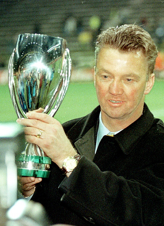 Louis van Gaal holds the Supercup after FC Barcelona won the Supercup vs. Borussia Dortmund in 1998