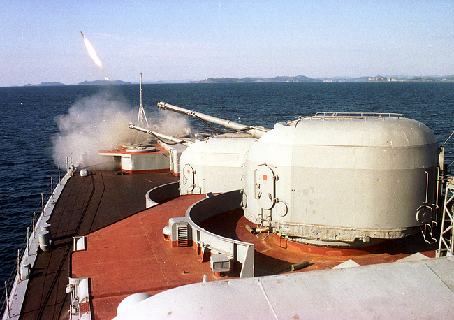 Gun mount of the Admiral Vinogradov destroyer fires during military exercise
