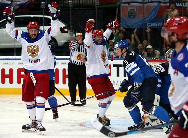 Artyom Anisimov (L) and Yegor Yakovlev (C) of Russia celebrate a goal