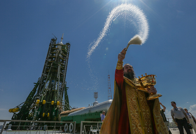 An Orthodox priest blesses the Russian Soyuz TMA-13M rocket booster