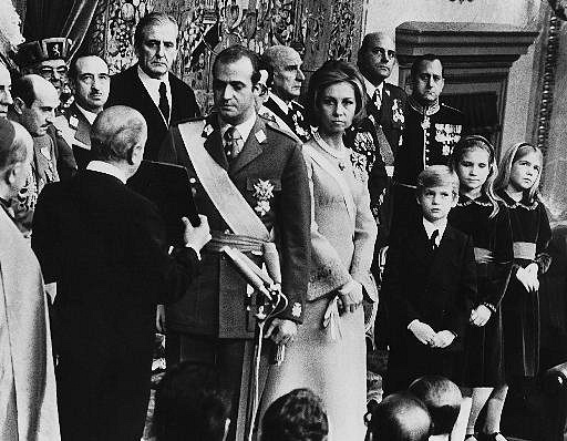 Juan Carlos became King on 22 November 1975, two days after Franco's death. Photo: Juan Carlos (C left) and Queen Sophia (C right) during the proclamation ceremony