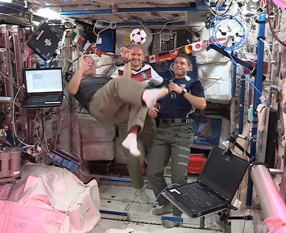 American astronauts Steve Swanson (left) Reid Wiseman (right) and German astronaut Alexander Gerst (center) kick around a soccer ball at the International Space Station