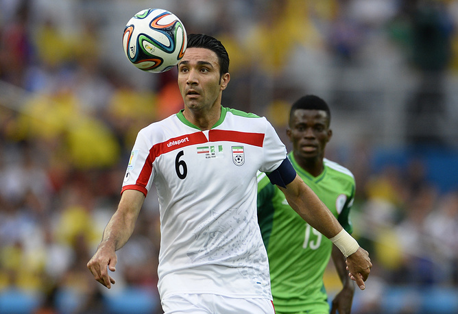Iran's Javad Nekounam controls the ball during the FIFA World Cup 2014 group F preliminary round match between Iran and Nigeria