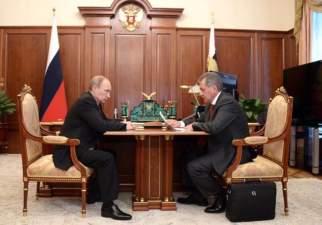 Russian President Vladimir Putin and Defense Minister Sergei Shoigu