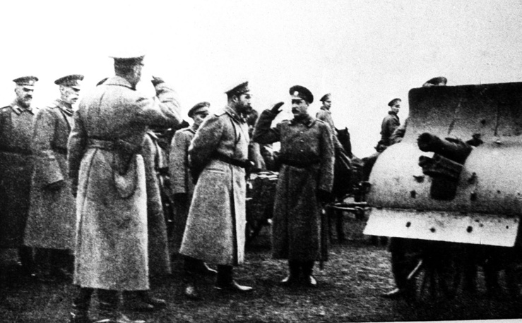 Russian Emperror Nikolai II listens to a report