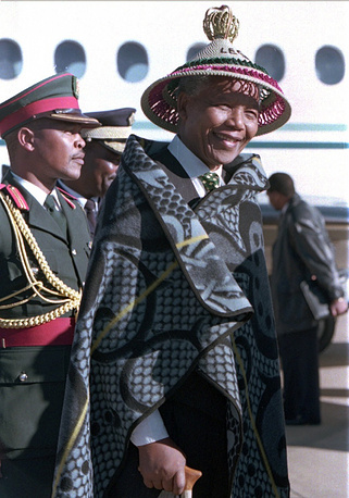 Forme South Africa president and Nobel Peace Prize winner of 2013 Nelson Mandela wears raditional Basotho dress given to him by King Moshoeshoe
