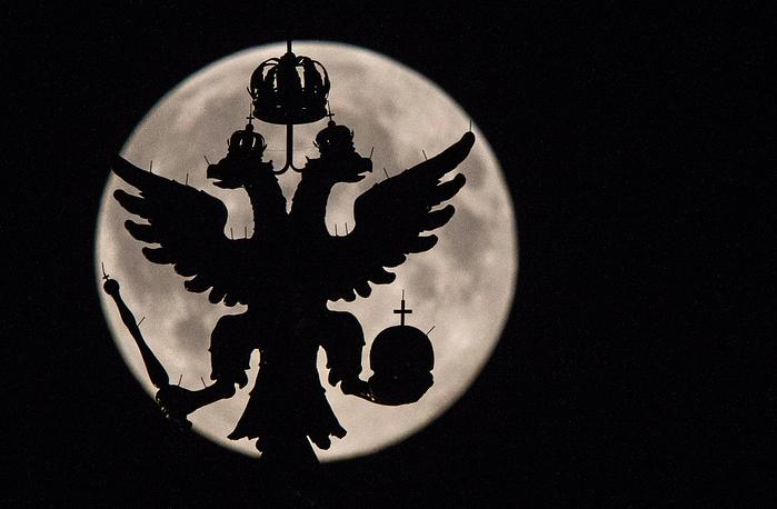 Full moon seen over Moscow's Kremlin