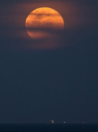 The August full moon over the beach of Ipanema in Rio de Janeiro