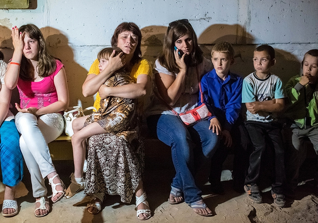 Students and staff members of a school in easter Ukraine's Sloviansk hide in a the basement during an attack of the Ukrainian army, 2014