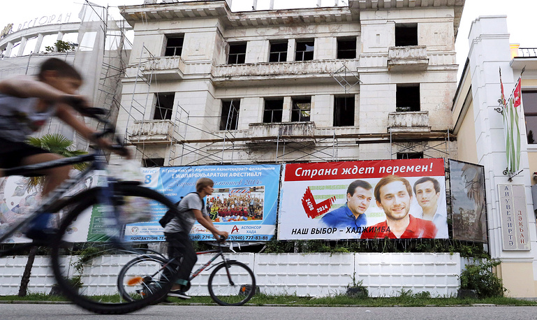 An election campaign ad promoting Abkhazia's presidential candidate Raul Khadzhimba in a street in Sukhum